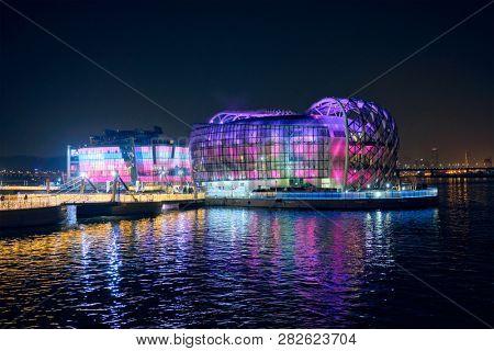 SEOUL, SOUTH KOREA - APRIL 7, 2017: Some Sevit culture complex on artificial floating islands located near the Banpo Bridge illuminated at night, Seoul, South Korea