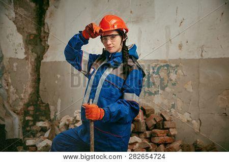Destroying Gender Stereotypes. Woman Wearing Helmet Using Different Male Work Tools. Gender Equality
