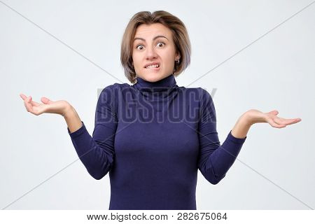 Young Girl Shrugging Shoulders. I Do Not Know Why Are You Shouting On Me.