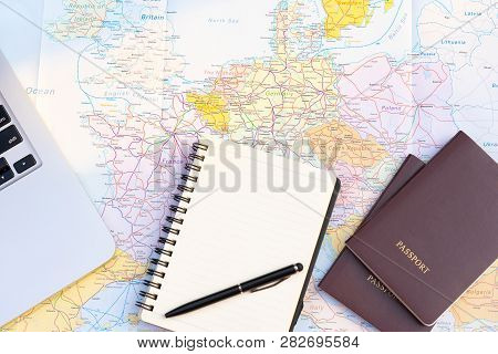 Passport On Europe Map Background.travel Planning.top View Of Traveler Accessories With Two Passport