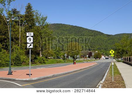 A Directional Sign On Beach Road In Lake George New York