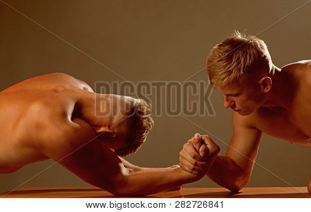 Trying Strength. Twins Competitors Arm Wrestling. Men Competitors Try To Win Victory Or Revenge. Twi