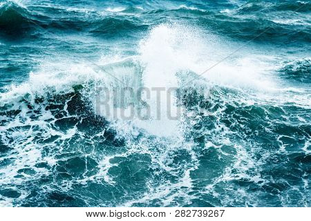 Beautiful stormy sea, abstract natural background, breaking waves, nature disaster, hurricane on the sea, power of the nature