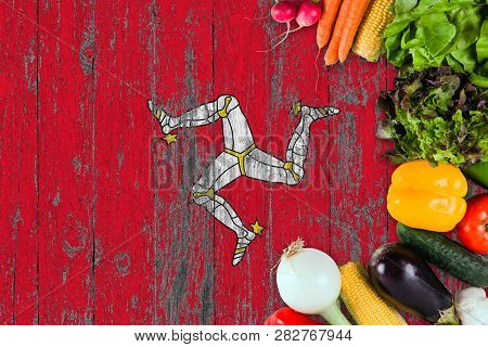 Fresh Vegetables From Isle Of Man On Table. Cooking Concept On Wooden Flag Background.