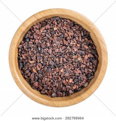 Cacao Nibs. Crushed Cocoa Beans In Wooden Bowl Isolated On White. Top View.