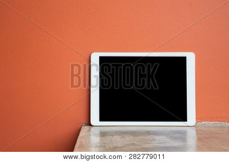 Cement Table With Blank Screen For Text On Tablet, Smart Phone, Cell Phone. Vertical Blank Screen On