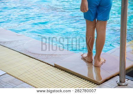 Child Swimmer Standing Pool Side. Concept Of Drowning.