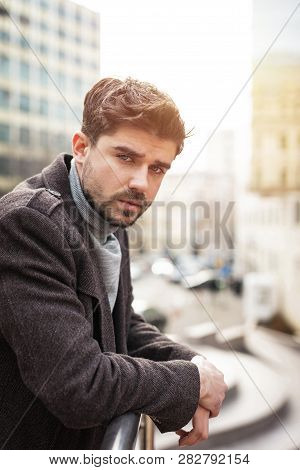 Young Elegant Man In Front Of A Hotel