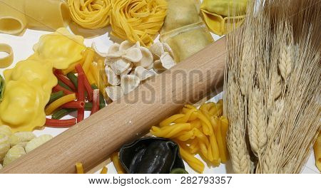 Italian Homemade Pasta With Various Formats Called Tagliatelle Tortellini And Ears Of Ripe Wheat And