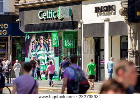 Glasgow, Scotland - May 28:  People Walking In Front Of Souvenir Shop Of Football Club Celtic Glasgo
