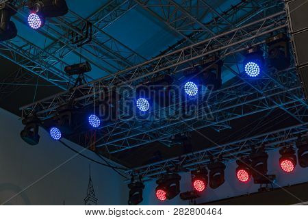 Professional Lighting Equipment Installed Above The Stage On Special Metal Frames.