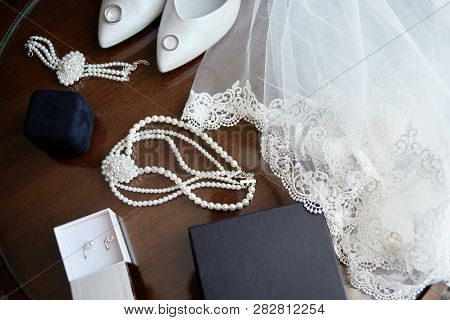 Top View Of Luxury Bridal Accessories. Veil, White Shoes, Golden Wedding Rings And Bride Jewelry (pe