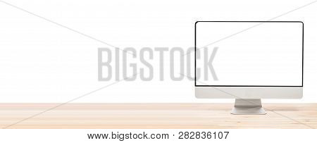 Conceptual Workspace Or Business Concept. Big Computer Monitor Display With Blank White Screen On Li
