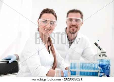 two scientists biologists sitting in a laboratory.