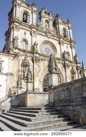 Exterior Front Of The Alcobaca Monastery, Or Mosteiro De Santa Maria De Alcobaca, In Portugal. No Pe