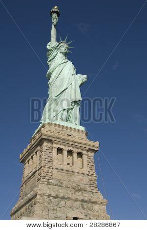 Statue of Liberty, Liberty Island closeup over blue sky.  New York City Manhattan
