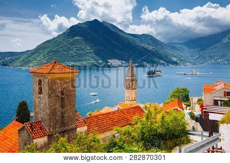 Wonderful scene of famous Kotor bay (Boka Kotorska) and St. Nikola Church. Location place Perast, Montenegro, Adriatic sea, Europe. Scenic image of tourist destination. Discover the beauty of earth.