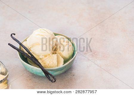Vanilla Bean Ice Cream. Vanilla Ice Cream In Bowl With  Vanilla Pods, Selective Focus, Copy Space