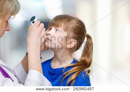 A Closeup Of Female Ophthalmologist Examining Eyes Of Small Child With Special Equipment At Hospital