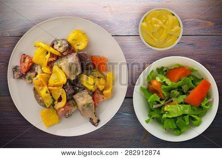 Vegetarian Food. Sauteed Eggplant On A Plate. Healthy Food On Wooden Background.