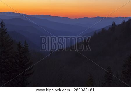 The Sun Rises Over Multiple Ridges And Valleys In The Smoky Mountains At Newfound Gap Near The Borde