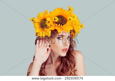 Woman With Floral Headband Hand To Ear Listening In Shock. Closeup Portrait Of Noisy Caucasian Fashi