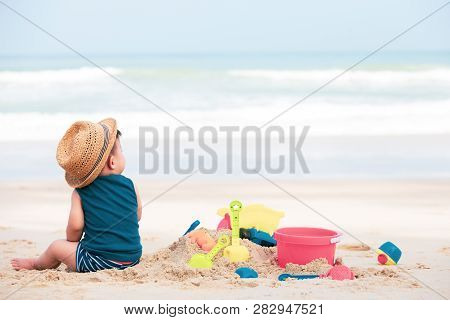 Asian Baby Boy Playing Sand On The Beach, Baby One Year Old