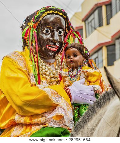 Latacunga, Ecuador - September 22, 2018 - Man Wears Mask Of Mama Negra During Annual Parade