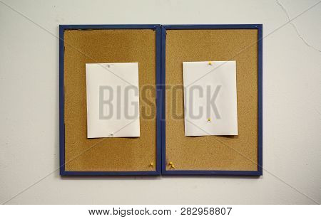 Simple Composition, Two Frames Of Cork With Blank White Papers On Wall.