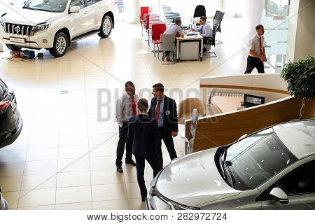 Kazan, Russia - August 31, 2018: Managers In Car Showroom Of Dealership Toyota In Kazan