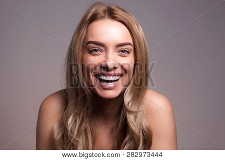 Healthy White Smile Close Up. Adult Beautiful Blond Woman With White Veneers On The Teeth. Beauty Wo