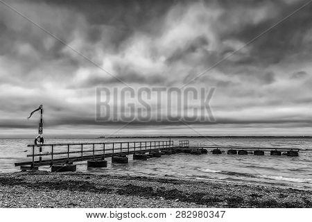 An Old Pier At Larod Beach Outside Helsingborg, Overlooking The Oresund Towards Denmark.