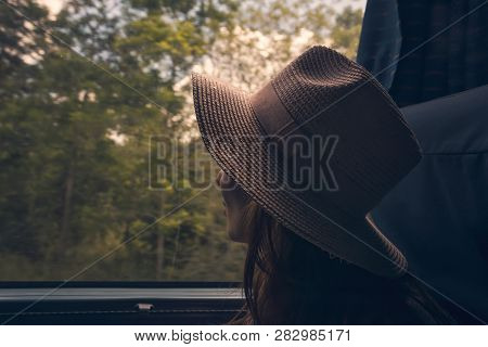 Traveler Girl Watching Through Bus Window. Young Traveler Girl In Vacation. Girl Traveling By Bus. T