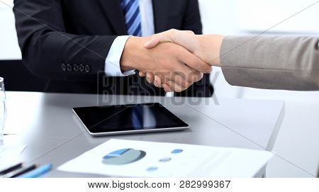 Business People Shaking Hands, Finishing Up A Meeting In Office, Unknown Human Group