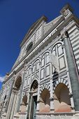 Facade of church of Saint Mary Novella in Florence Italy and an old sundial in stone poster