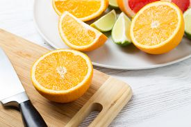 Fresh Citrus Fruits On White Wooden Table