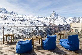 Zermatt, Switzerland - April 12, 2017: Empty Chair Cussion In A Bar And Restaurant In The Matterhorn