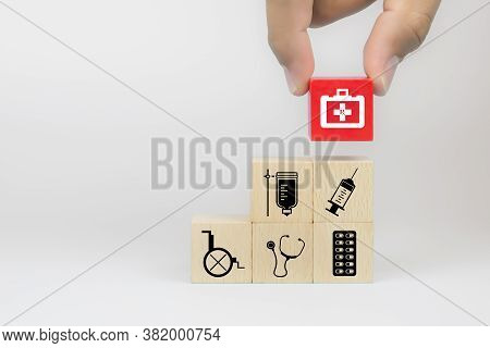 Hand Choose Medical Tool Bag Icon On Cube Wooden Toy Blocks Stack In With Other Hospital Medical Sym
