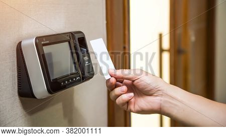 Office Man Using The Id Card To Scan At The Access Control System Machine For Check Attendance And O