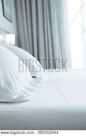 Pillows With White Covers On Luxury Hotel King Size Bed. No People