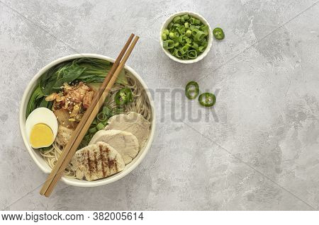 Miso Ramen Asian Noodles With Egg, Chicken, And Pak Choi Cabbage In Bowl. Japanese Cuisine. Top View