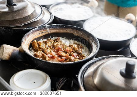 Steamy Hot Clay Pot Chicken Rice Being Cooked In Restaurant. Popular Food In Malaysia