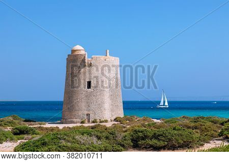 Beautiful View Of The Old Observation Tower (torre De Ses Portes) And Sailing Yacht Off The Coast Of