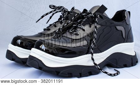 Black And White Sneakers, High-soled, On A White Background.