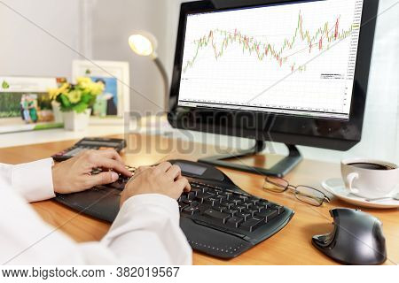 Business And Financial Concept  Hands Of Business Women Use Pc Computer Trade Stock Market With Cand