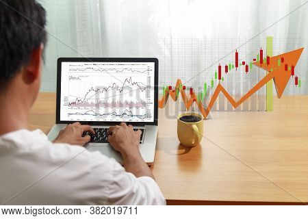 Business And Financial Concept Bbusinessman Use Laptop Computer Trade Stock Market With Candlestick