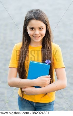 Cheerful Girl Hold Book. Back To School. Happy Kid With Notebook. Education For Children. Reading An