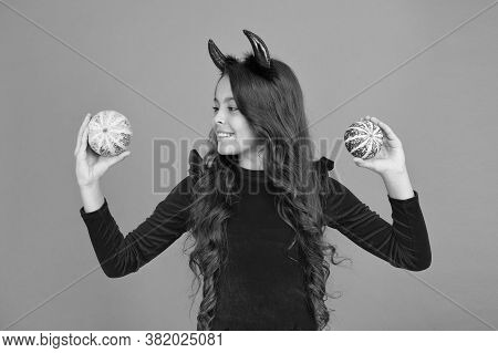 Creepy Crawly. Happy Little Girl Hold Pumpkins Orange Background. Small Child Dressed Up As Creepy D
