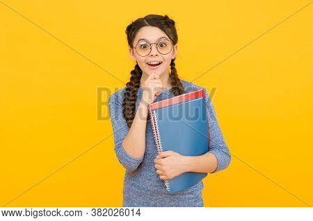 What A Surprise. Surprised Child Hold Books Yellow Background. Little Girl Open Mouth With Surprise.