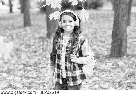 Schoolgirl Listening Modern Headphones. Headphones Technology. Cute Child Smile With Stereo Headphon